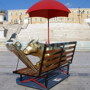 golden-cow-reading-under-a-red-umbrella_surrealism