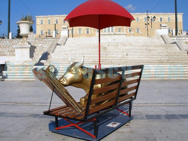 golden-cow-reading-under-a-red-umbrella_surrealism